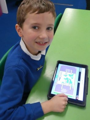 A boy uses a tablet to create a labelling activity on Purple Mash