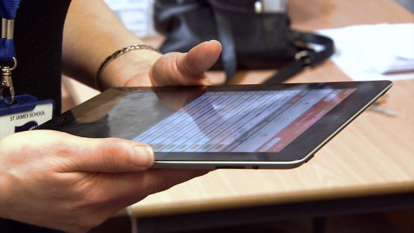 Teacher using Teacher Portal on iPad