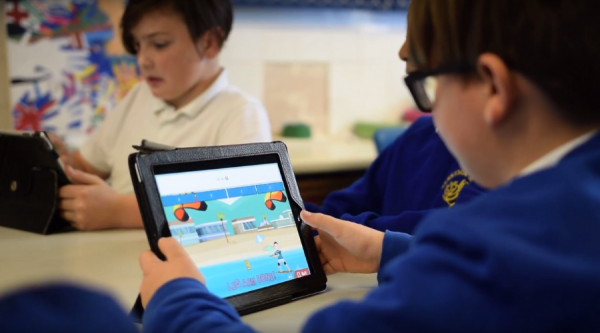 Pupils using Sumdog on tablets in class