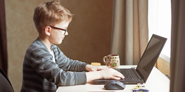 Boy at desk with laptop
