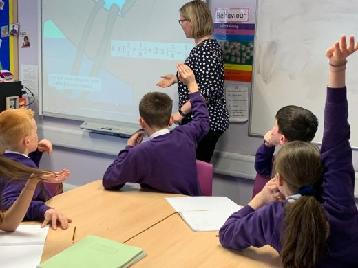 A teacher using a Classroom Secrets Learning Video Clip with her class at Thackley Primary School