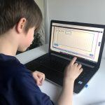 A child using an interactive arithmetic activity on Classroom Secrets Kids