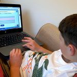 A child using an interactive grammar activity on Classroom Secrets Kids