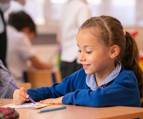 Image of pupil at desk