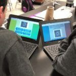 Students completing a Quizalize quiz on their devices and working together.