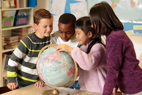 School children around a globe