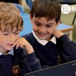 Primary school children using MyMaths on laptops